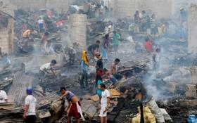 ویرانی یک حلبی آباد در حومه مانیل در اثر آتش سوزی