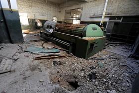 یک دستگاه ریسندگی در سالن کارخانه ریسندگی سابق در حلب