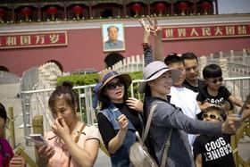 روز کارگر در میدان تیان آن من در پکن مرکز چین