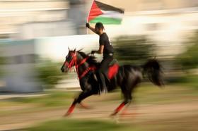 نمایش سواری اعتراضی در غزه یک فلسطینی
