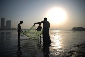 ماهیگیران در ساحل دهلی نو