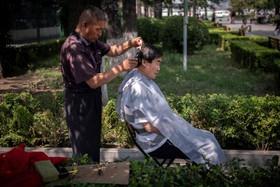 (تصاویر) سلمانی دوره گرد در چین