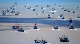 (تصاویر) کشتی های ماهیگیری چینی در در یای چین پس از سه ماه ممنوعیت ماهیگیری