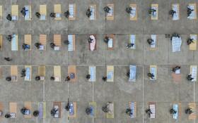 (تصاویر) رقابت ملافه تا کنی میان دانشجویان تازه وارد در یانگزو چین