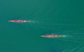 (تصاویر) مسابقه قایق سواری سنتی اژدها در گوانگشی در چین
