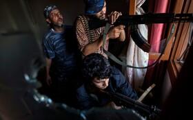(تصاویر) جنگجویان متحد نیروهای سازمان ملل حامی حاکم در لیبی موسوم به واحد شلبا در تریپولی در حال جنگ با نیروهای ضد دولتی