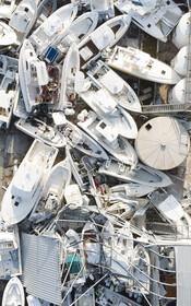 (تصاویر) قایق های تخریب شده از توفان دورین در جزیره البو در باهاماس