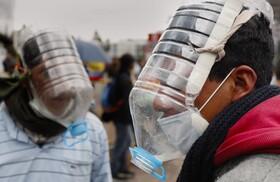 (تصاویر) تظاهرکنندگان اکوادوری با وسایل خانگی وسایل ضد گاز آشگ آور و فلفل ساخته اند