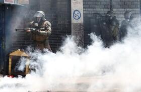 (تصاویر) مقابله نیروهای ضد شورش با تظاهرکنندگان در شیلی