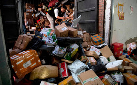 (تصاویر) انبار یک مرکز توزیع خرید در چین در روز جهانی خیرد که به جمعه خونین مشهور است.
