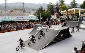 (تصاویر) عکسی از حرکت دوچرخه سوار ژاپنی ریمی ناکامورا در جریان مسابقات جهانی سال جاری در توکیو