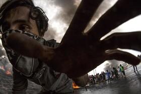 (تصاویر) تظاهرکننده ای در بصره عراق
