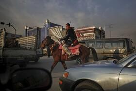 (تصاویر) ترافیک در کابل افغانستان و کودک اسب سوار