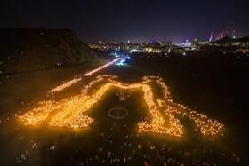 (تصاویر) تصویر سازی با نور توسط شرکت کنندگان در جشنواره ای در ادینبورگ اسکاتلند