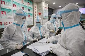 (تصاویر) کارکنان مرکز بهداشتی در وهان چین در حال کار