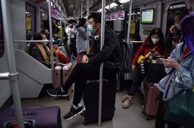 (تصاویر) مسافران مترو در شانگاهی چین که همه با ماسک برای جلوگیری از بیماری کرونا مجهز هستند