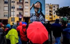 (تصاویر) رونمایی از یک اثر هنر خیابانی در لیسبون پرتغال اثر نومن به نام ماسکت را بردار