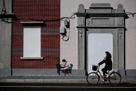 (تصاویر) خیابانی خلوت در شانگهای چین و نقاشی دیواری