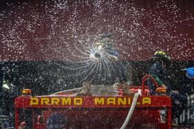 (تصاویر) ضد عفونی کردن یک بازار در مانیل فلیپین برای جلوگیری از شیوع کرونا