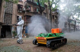 (تصاویر) پاکسازی خبابان ها در ووهان چین با ربات های خودکار