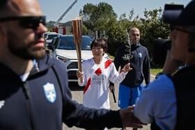 (تصاویر) حمل مشعل المپیک توسط قهرمان دو ماراتن ژاپن در یونان بدون حضور جمعیت