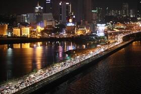 (تصاویر) ترافیک در اتومان مرزی بین مالزی و سنگاپور پیش از اعلام منع مسافرت میان دو کشور