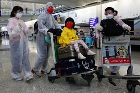 (تصاویر) مسافران در فرودگاه هنگ کنگ