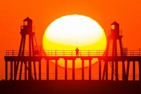 (تصاویر)طلوع آفتاب در ساحل