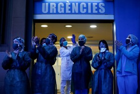 (تصاویر) کارکنان مرکز بهداشتی در بارسلونا در اسپانیا
