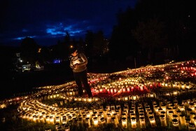 (تصاویر) روشن کردن شمع به یادبود کشته شدگان بیماری کوید نوزده یا کرونا در آفمان
