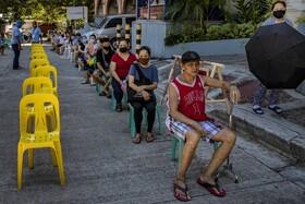 (تصاویر) صف متقاضیان برای آزمایش کوید نوزده کرونا در فلیپین