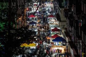 (تصاویر) بازار شبانه ای در ووهان چین پس از باز گشایی مراکز تجاری در این منطقه