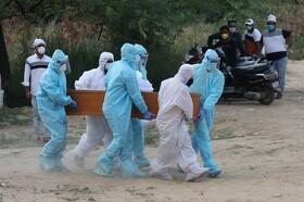 (تصاویر)تدفین جسد مبتلایان به کوید نوزده کرونا در دهلی نود