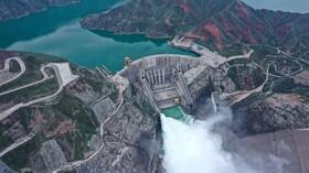 (تصاویر)رهاسازی آب از سد لیجایخی در چین برای آمادگی باران های سیل آسا