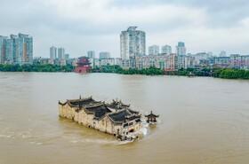 (تصاویر) سیل در ووهان چین که 141 کشته و مفقود با 15 میلیون بی خانمان برجا گذاشت