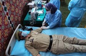 (تصاویر) تست خون از پلیسی در هند که به کرونا مبتلا شده بوده